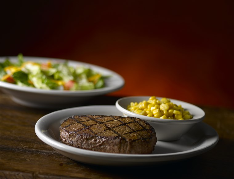 Texas Roadhouse 6 ounce sirloin steak with corn and salad