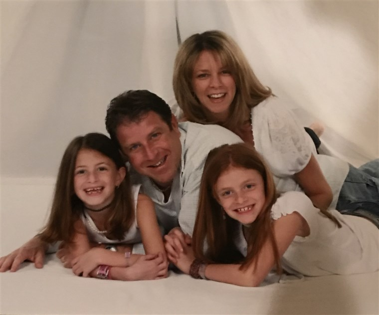 Stacy Feintuch is pictured with her family before the death of her husband in 2011.