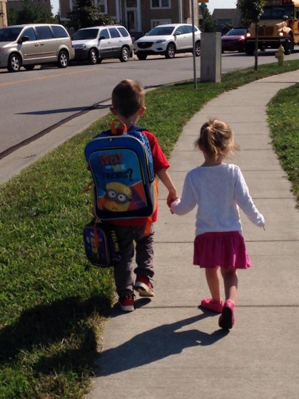 Klein children walking off to school