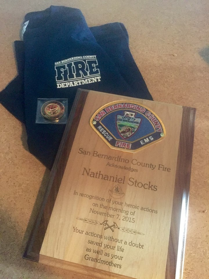 Натаниел Stocks was honored by his local fire department after saving his grandmother's life during a fire