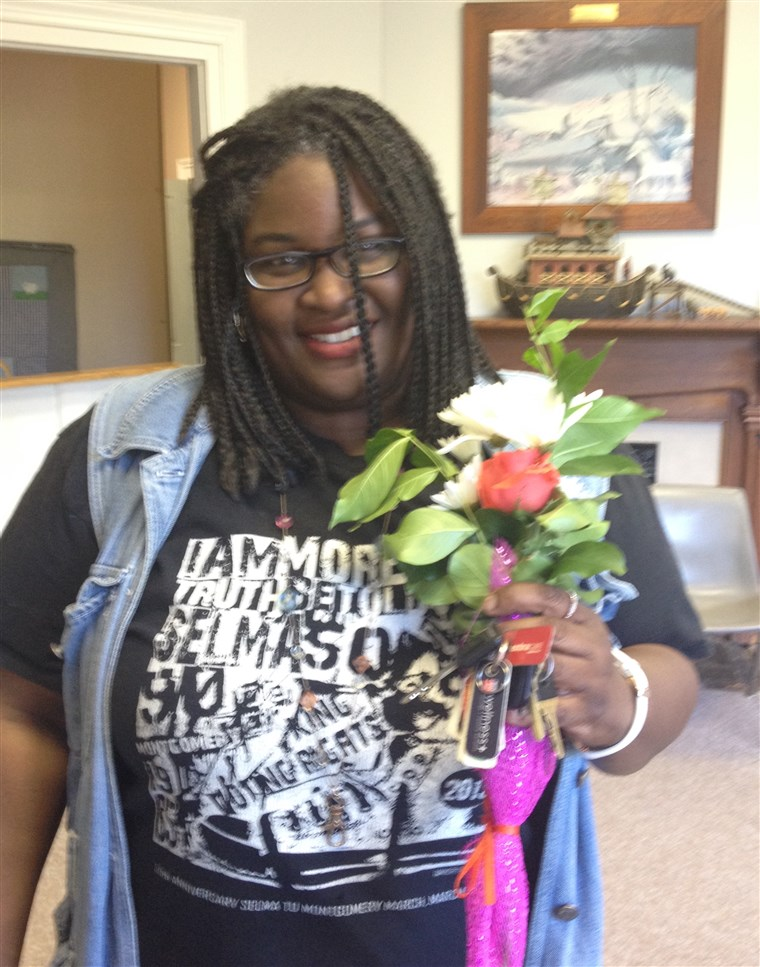 Darlesa Brown, one of the organization's adopted moms, with her Mother's Day flowers.