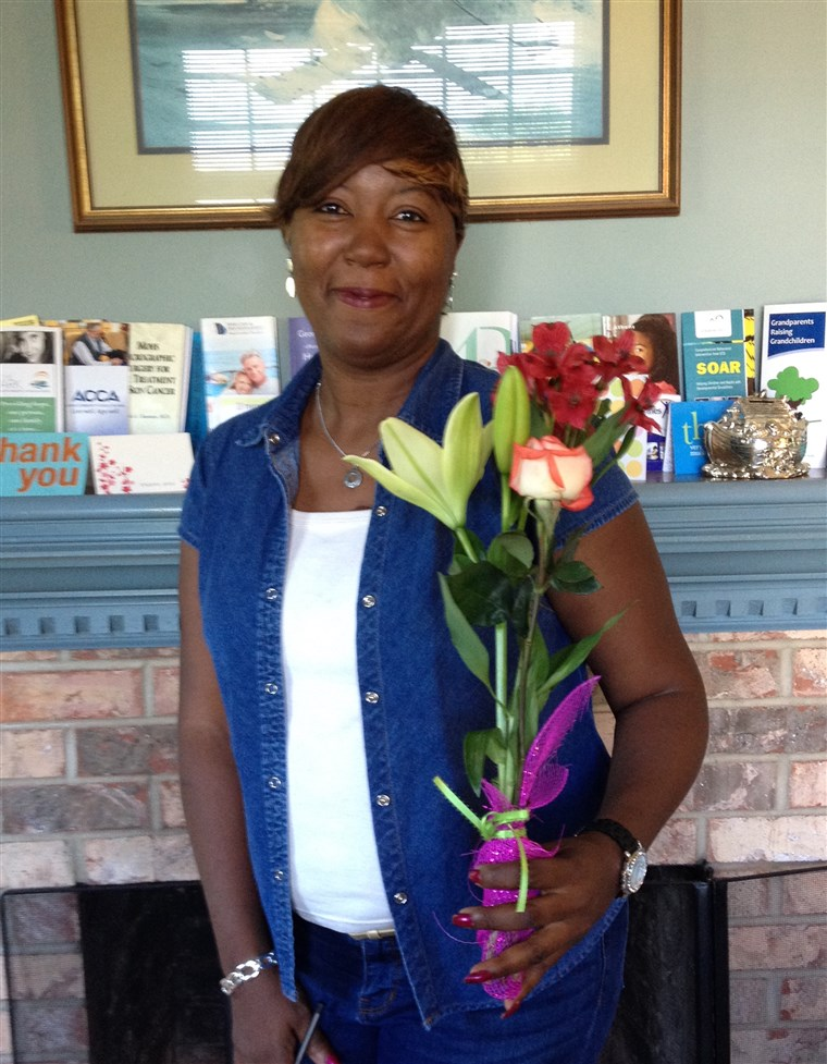 Хуана Hulin with the Mother's Day bouquet from her Adopt-a-Mom sponsor.