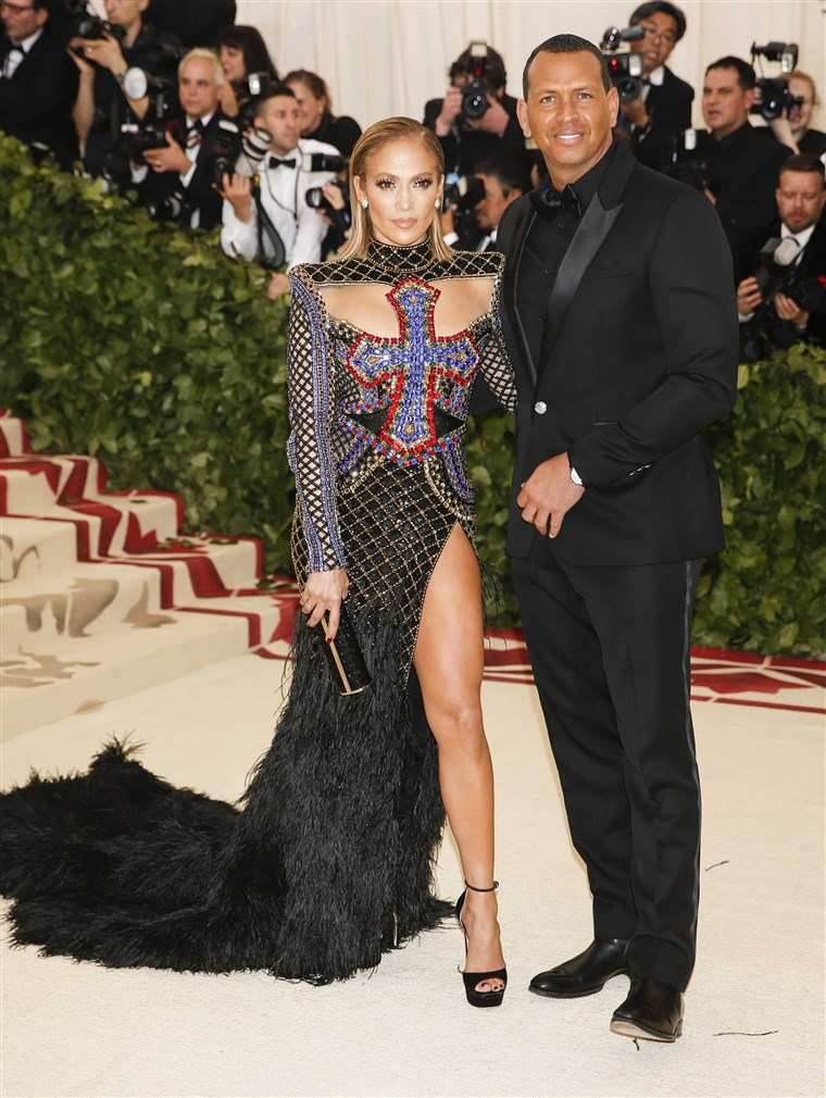 Jennifer Lopez and Alex Rodriguez pose on the carpet at the 2018 Met Gala