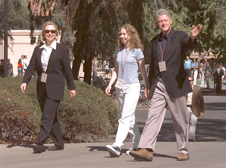 НАС President Bill Clinton (R) walks with US First