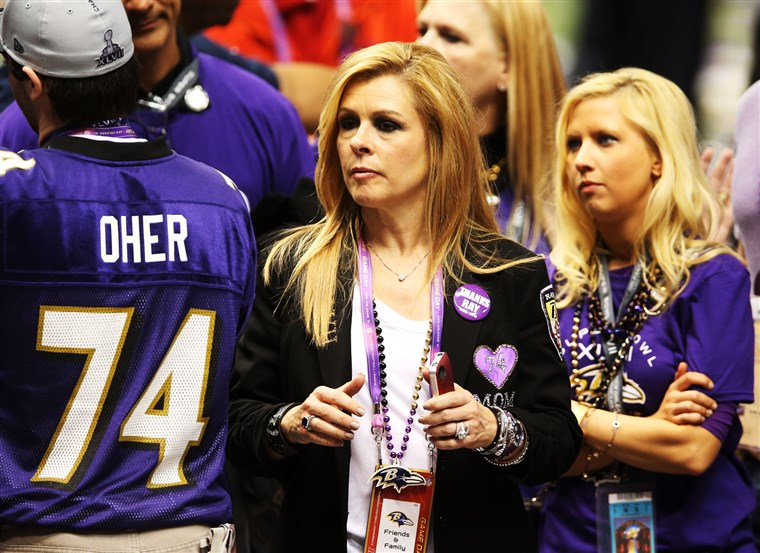 لي Anne Tuohy celebrates on the field after her adoptive son Michael Oher and the Ravens won the Super Bowl.