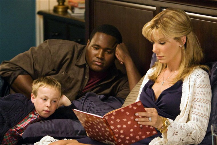 ساندرا Bullock and Quinton Aaron played Leigh Anne Tuohy and Michael Oher in the film 'The Blind Side.'