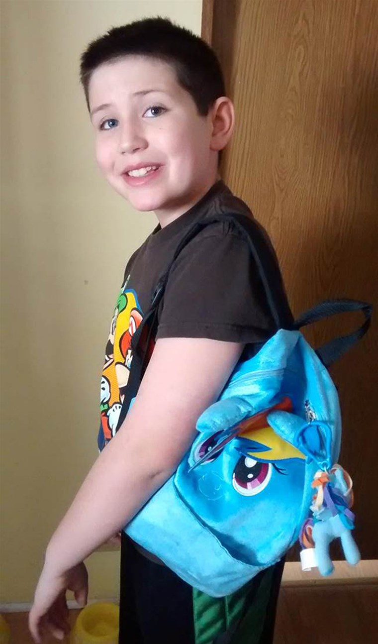 صورة: Grayson Bruce, 9, with his My Little Pony backpack.