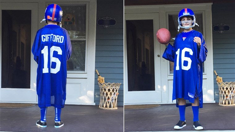 Joanne LaMarca's son, Mack, shows off the front and back of his Frank Gifford jersey.