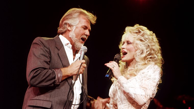 DOLLY PARTON duets with Kenny Rogers in July 1989