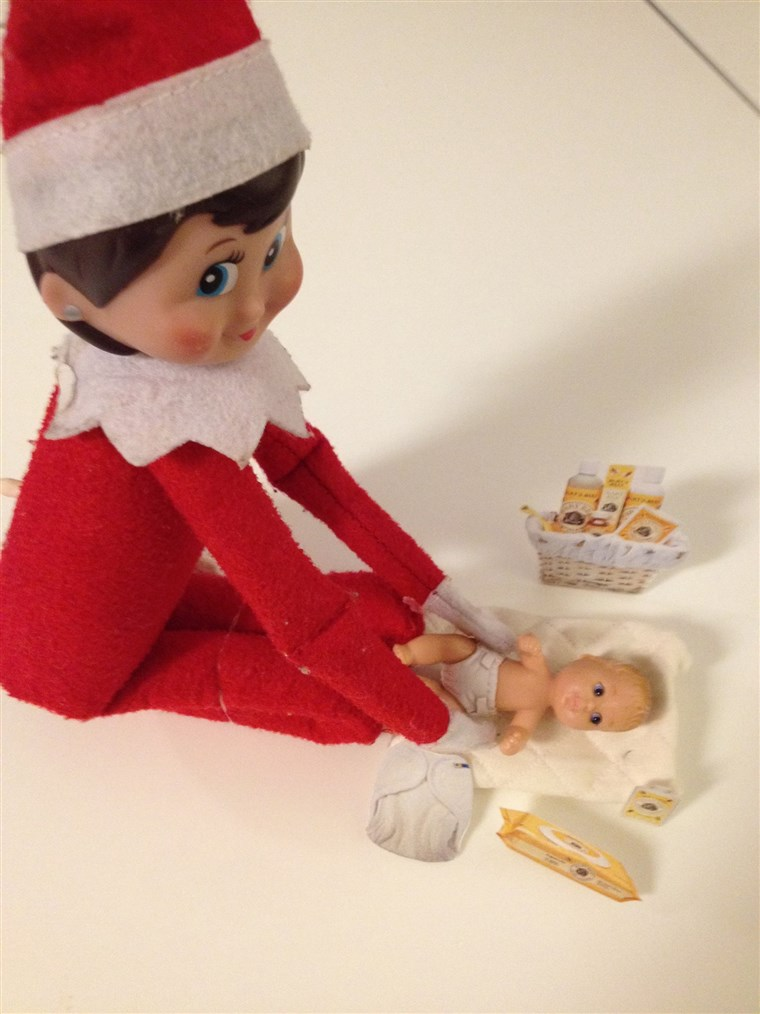 Das Elf changes baby doll diapers!