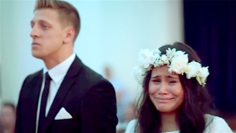 Hochzeit couple react emotionally to Maori haka dance being performed.