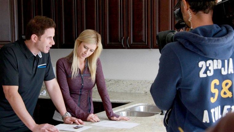 丈夫 and wife team, Tarek and Christina El Moussa, discuss renovation plans on the set of HGTV's Flip or Flop.