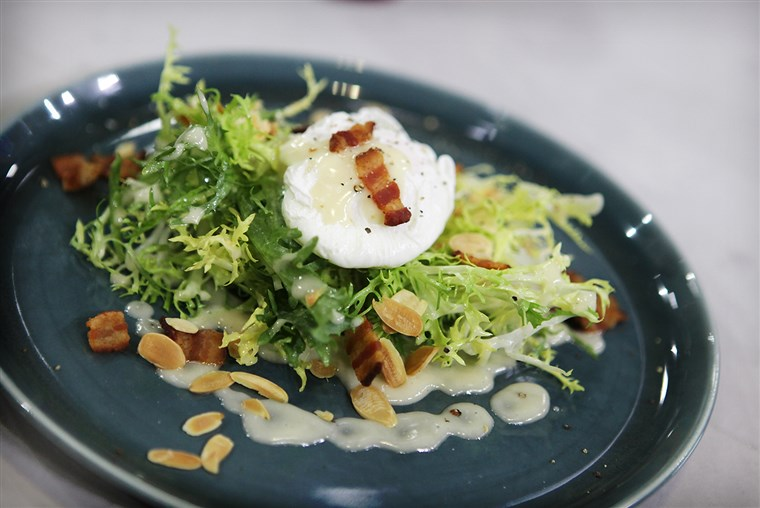 مسلوق eggs, frisee salad with bacon lardon, toasted almonds and Dijon vinaigrette