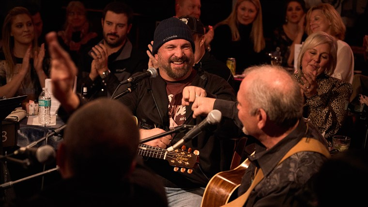Kent Blazy and Garth Brooks perform at the Bluebird Cafe in Nashville on Feb. 1.