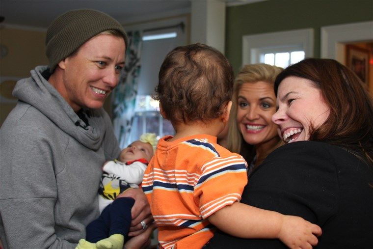 دويل and wife, Abby Wambach, visit with residents of Hope on Haven Hill.