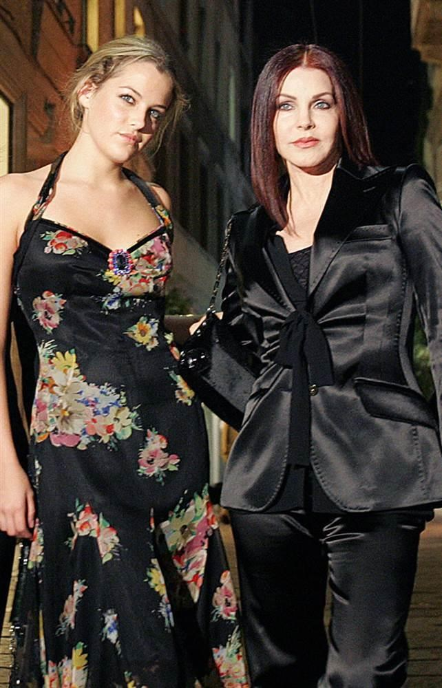 Elvis Presley's grandaughter Danielle Riley Keough and former wife Priscilla Presley pose before a party in October 2004.