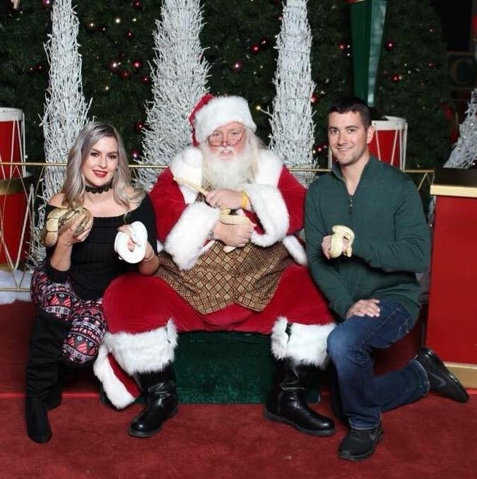 Amanda Nagy and her boyfriend, Bob Kelly, have been taking their pet reptiles to have photos taken with Santa Scott for the last few years.