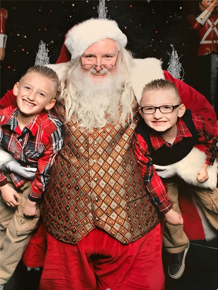 Alyssa Kitchenman's sons, Aiden, 9, and Landen, 7, with Santa Scott.