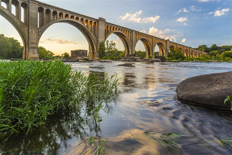 Tento concrete arch railroad bridge spanning the James River was built by the Atlantic Coast Line, Fredericksburg and Potomac Railroad in 1919 to route transportation of freight around Richmond, VA.